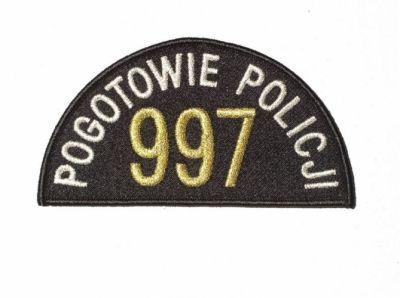 """Emblemat policji """"pogotowie policji – 997"""""""